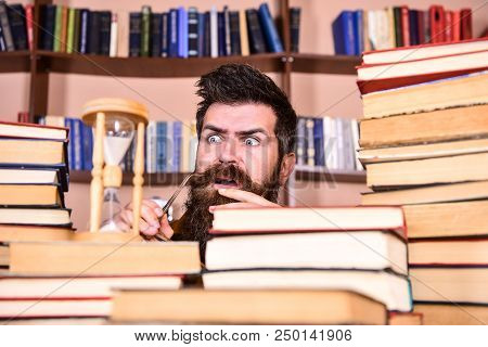 Man, Scientist Looks At Hourglass. Man On Serious And Shocked Face Watching Time Is Going Over, Book