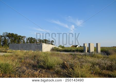 Abandoned construction site of the military facility. Forgotten structure. poster