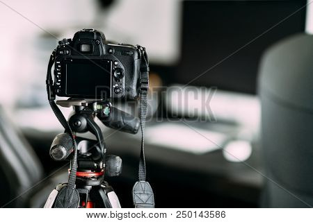 Professional Photographer Taking Interior Design Photos Using Professional Gear, Camera And Tripod