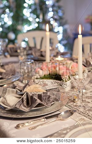 Christmas tree and fancy dinner table with folded napkins