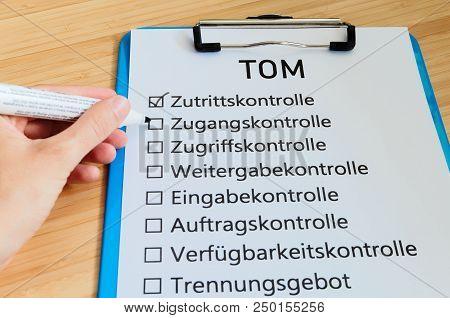 Plate With The Inscription Tom (technisch Organisatorische Maßnahmen)  In English Technically Organi