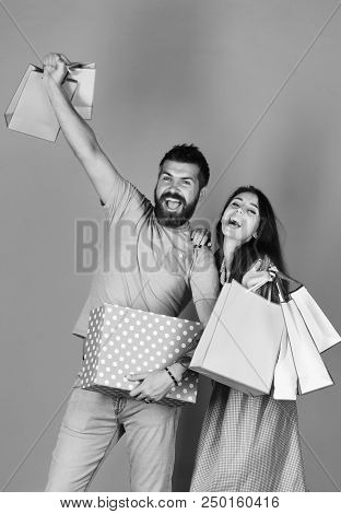 Man With Beard Holds Polka Dotted Box. Shopping And Spending Concept. Guy With Beard And Girl With E