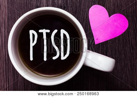 Handwriting text Ptsd. Concept meaning Post Traumatic Stress Disorder Mental Illness Trauma Fear Depression Mug coffee lovely thoughts ideas love hart romantic memories brown wood poster