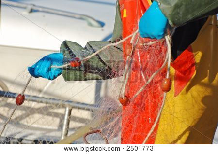 Fisherman Controlling Net