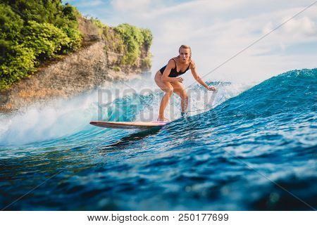 Attractive Surf Woman On Surfboard. Woman In Ocean During Surfing.