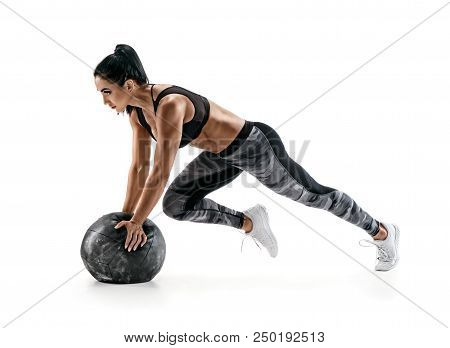 Strong Woman Workout With Medicine Ball. Photo Of Latin Woman In Military Sportswear Isolated On Whi