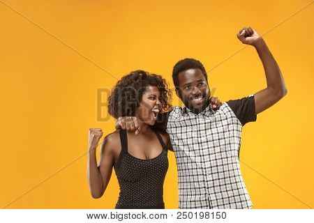We Won. Winning Success Happy Afro Man And Woman Celebrating Being A Winners. Dynamic Image Of Cauca
