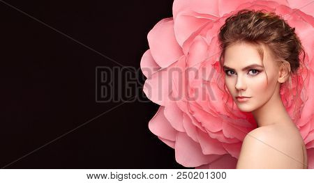 Beautiful Woman On The Background Of A Large Flower. Beauty Summer Model Girl With Pink Peony. Young