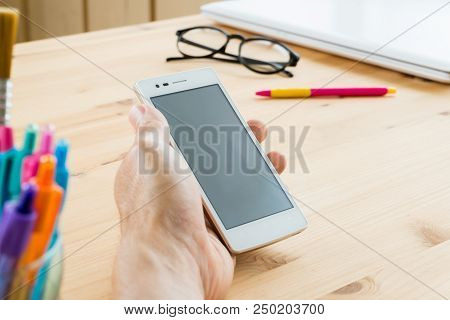 Smartphone Or Mobile Phone On Hand Close Up