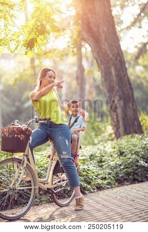 Family Sport And Healthy Lifestyle -happy Mother And Son Riding A Bicycle Together Outdoors In A Cit