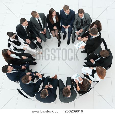 large group of business people sitting at a business meeting