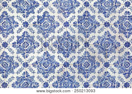 Traditional Portuguese azulejo tiles on the building in Porto, Portugal. Background texture.