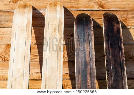 Wide Forest Skis Near Wooden Wall Of Country House In Winter In Russian Village In Smolensk Region O