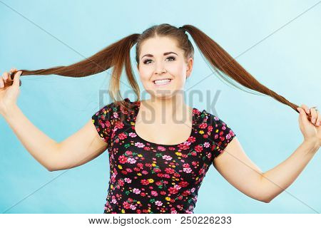 Education, teenage adolescence, happiness concept. Happy teenager student girl with ponytails having fun poster
