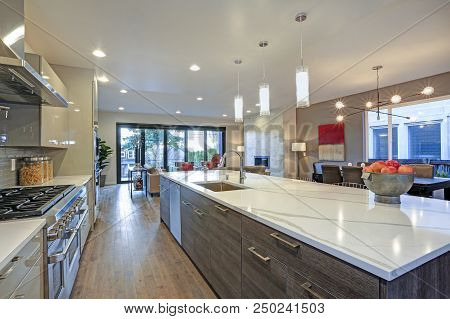 Sleek Modern Kitchen Design With A Long Center Island.