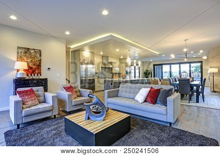 White And Gray Living Room Interior With Open Floor Plan.