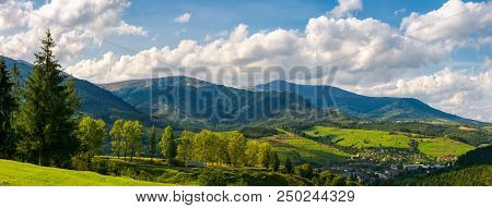 Panorama Of Mountainous Urban Area. Lovely Countryside Landscape In Early Autumn. Trees Along The Ro