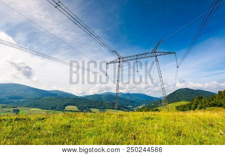 High Voltage Power Lines Tower In Carpathian Mountains. Lovely Green Energy Industry Concept. Beauti