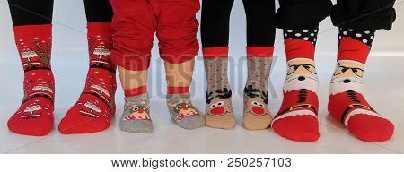 Family Of Four Wearing Christmas Socks. Happy Family At Home. Christmas Holidays Concept