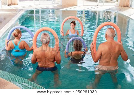 Senior group in the swimming pool in a back exercises course in rehab