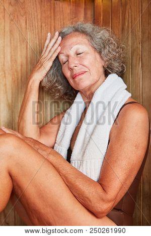 Senior enjoys her retirement and sweats in the wellness sauna