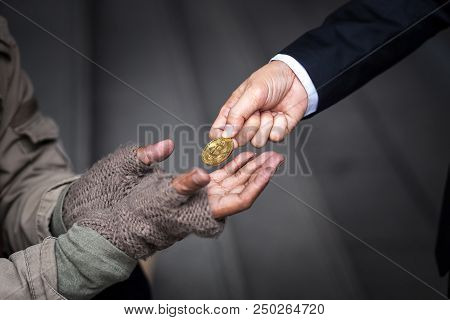 Business Man Give, Donate, His Gold Bitcoin To Homeless Man In Downtown Of Business Zone