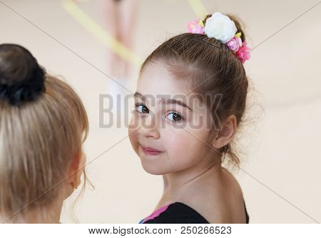 Little Cute Ballerina In Studio Looking On Camera. Sport, Training, Fitness, Stretching, Dancing, Yo