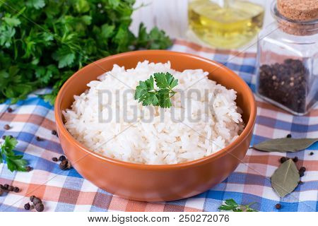 White Rice In Bowl. Rice On Wooden Table