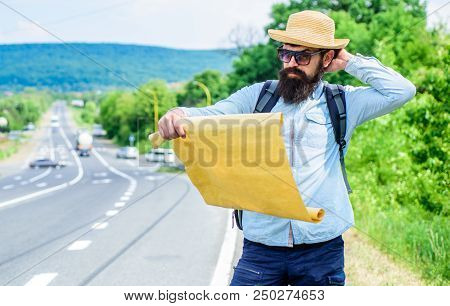 Carry Good Map. Tourist Backpacker Looks At Map Choosing Travel Destination At Road. Allow Recognize