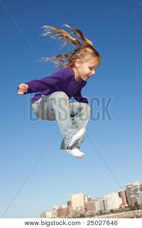 jumping little girl