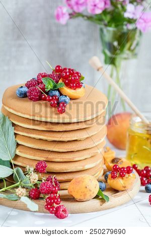 Fresh Delicious Pancakes With Summer Raspberries, Blueberries, Red Currants, Apricot, Peach And Mint