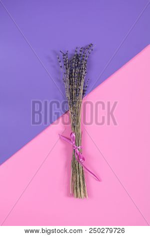 Beautiful Dried Lavender Bouquet On Violet Pink Surface. Top View, Copy Space. Nice Holiday Wedding