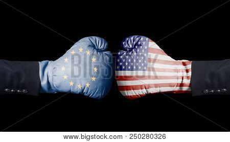 Boxing Gloves With European Union And Usa Flag. European Union Versus Usa Concept.isolated On Black