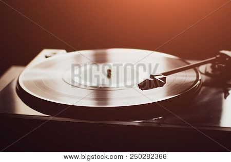 Vintage Record Player With Vinyl Disc, Close-up. Warm Sunlight.