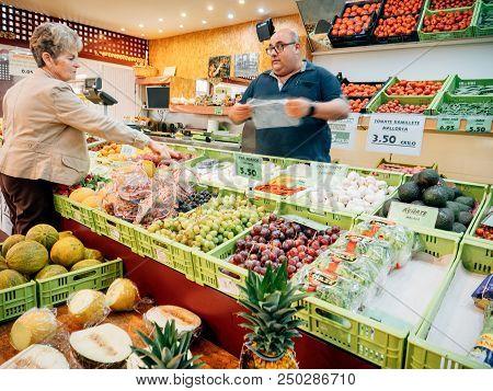 Felanitx, Palma De Majorca, Spain - May 10, 2018: Spanish Senior Woman Buying Fruits And Vegetables