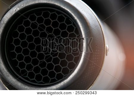 Close-up Detail Exhaust Pipe Of Big Bike. Hexagon Unique Pattern Of Racing Motorcycle Exhaust Pipe.
