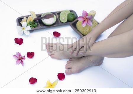 Spa Treatment And Product For Feet Spa With Flowers And Water, Wooden Background; Select And Soft Fo