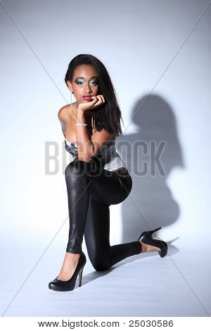 African American Woman In Leggings And Stilettos