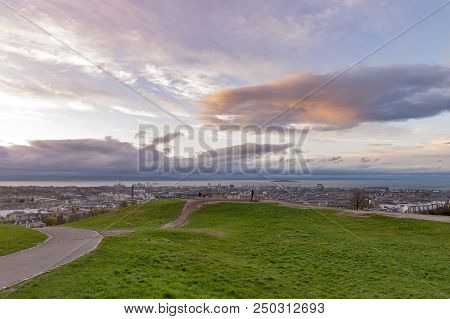 Hilltop Landscape On Calton Hill During Sunset Before The Rain, Overlooking The City Of Edinburgh An