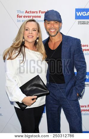 LOS ANGELES - JUN 11: Devon Odessa, Wilson Cruz at The Actors Fund's 22nd Annual Tony Awards Viewing Party at the Skirball Cultural Center on June 10, 2018 in Los Angeles, CA