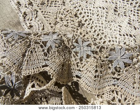 Beautiful  vintage  lace background  on the table .Russian bobbin lace. poster
