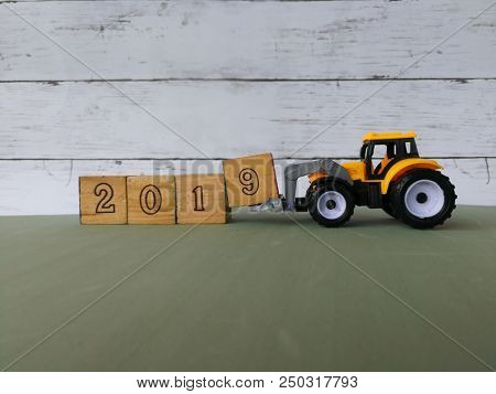 Toy bulldozer with 2019 wooden blocks