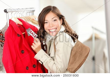 Shopping Woman At Clothes Sale