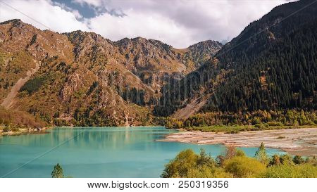 Idyllic Summer Landscape With Clear Mountain Lake. Mountain Lake Landscape. View Of The Sunny Mounta