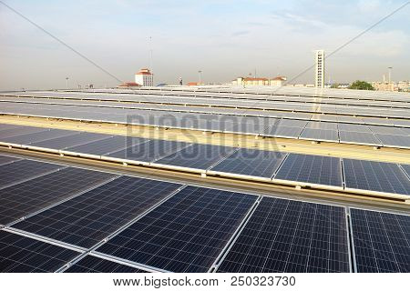 Large Solar Pv Rooftop On Warehouse Roof With Technician