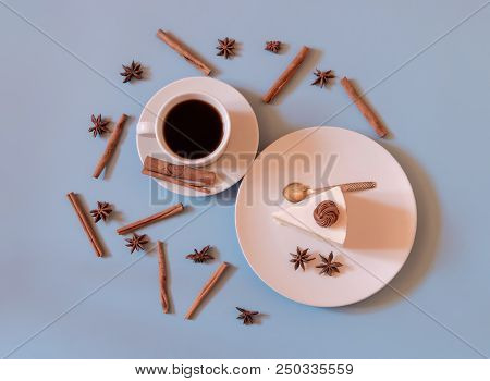 Cup Of Coffee With Cake And Spices. Top View.