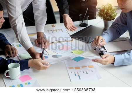 Business Meeting With Paper Chart And Laptop Computer Tablet On Table,consult Concept.