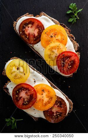 rye bread with cream cheese and color tomatoes