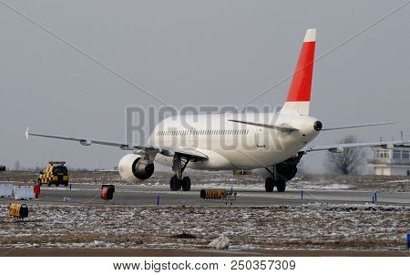 Passenger Jet Moving On The Runaway Tarmac