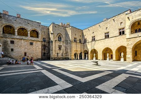 Rhodes, Greece - September 12 2017: Tourists Relax In The Shade Inside The Courtyard Of The Palace O